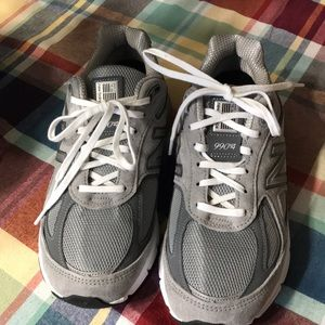 Grey and white new balance sneakers
